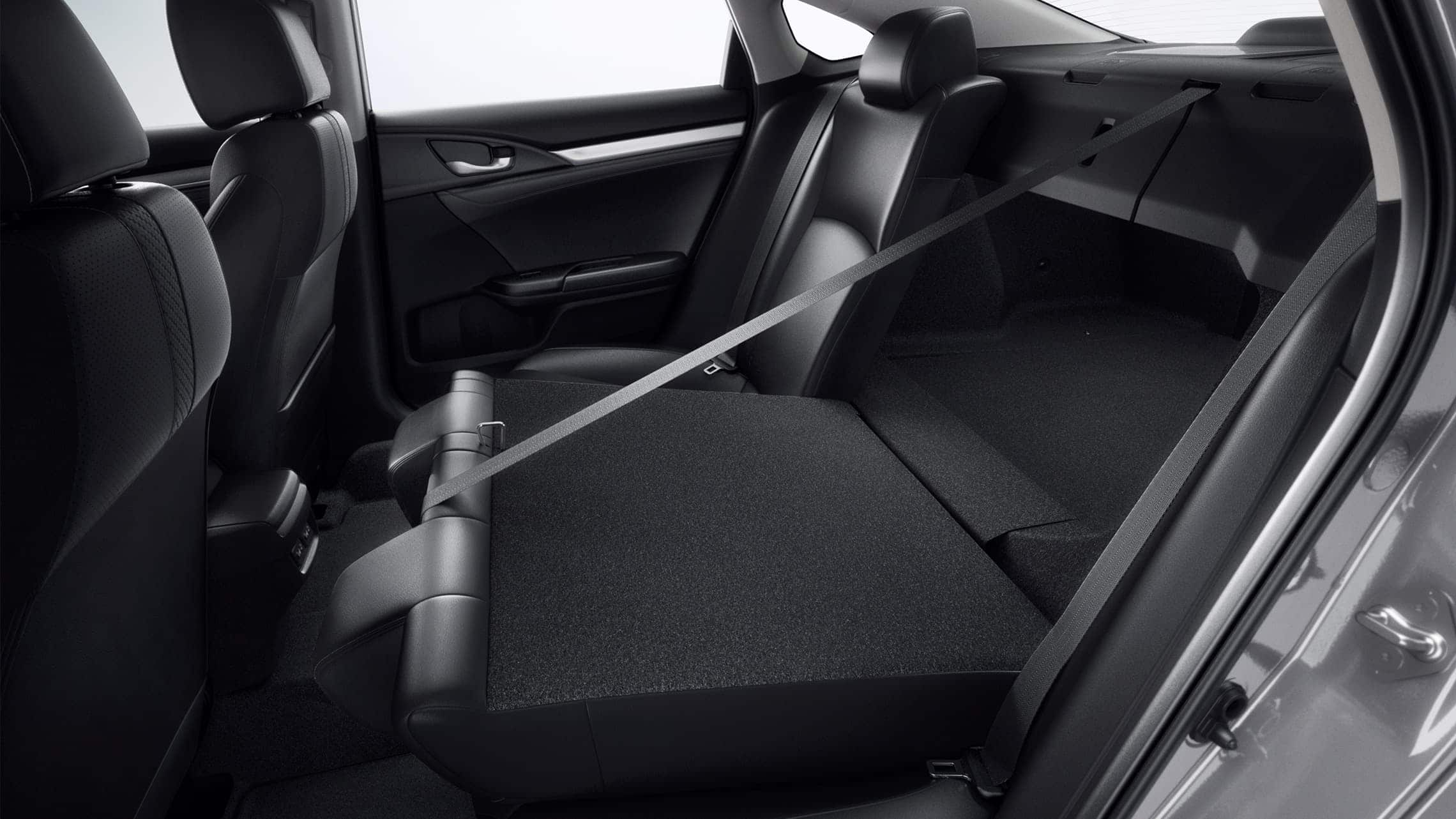 Interior view of 60/40 split fold-down rear seatback in the 2020 Honda Civic Touring Sedan with Black Leather.