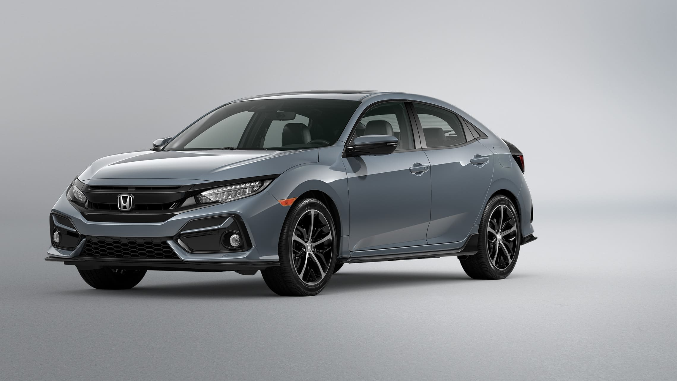 Front driver-side view of the 2021 Honda Civic Sport Touring Hatchback in Sonic Gray Pearl.