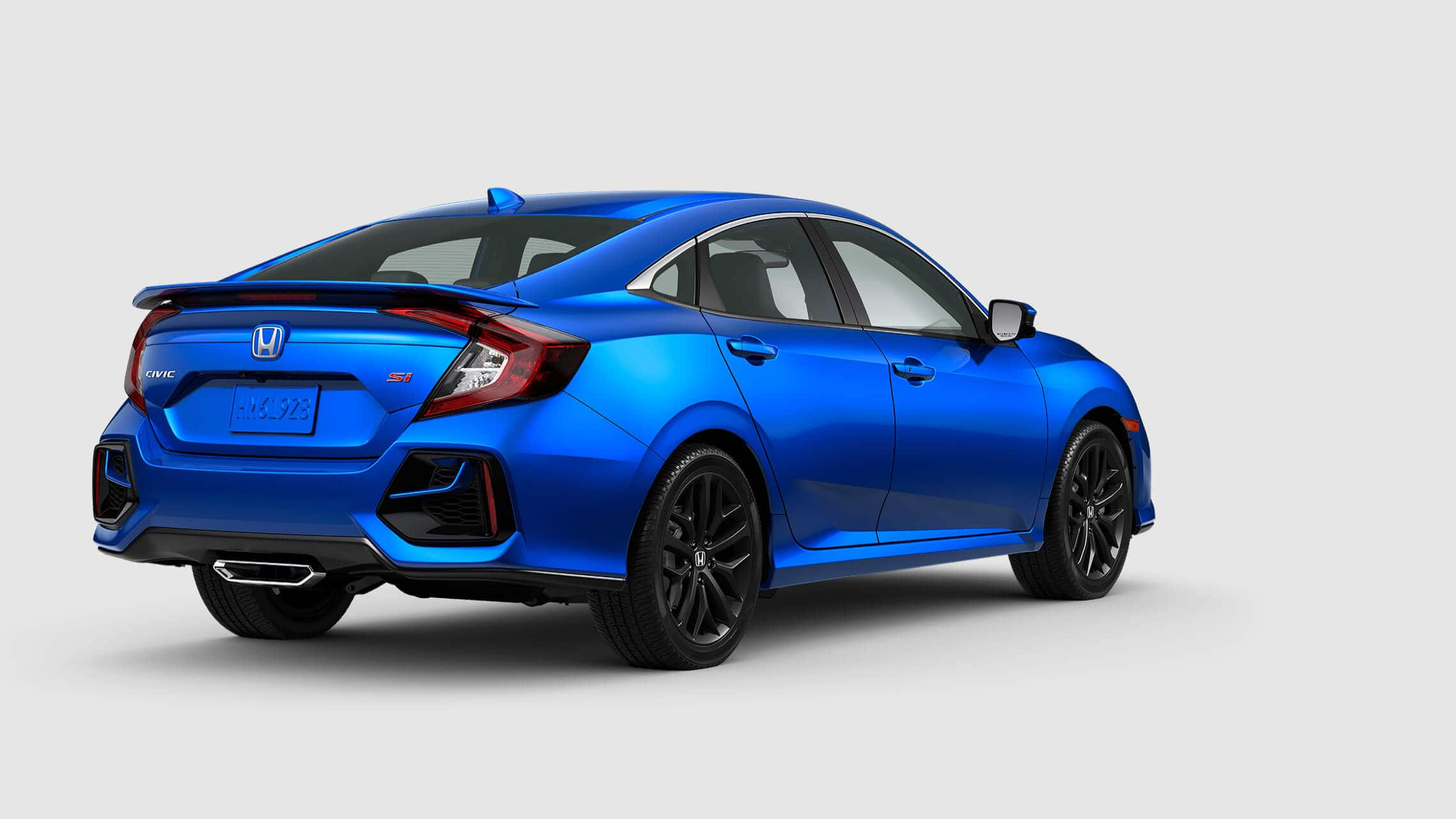 Rear view of 2020 Honda Civic Si Sedan in Aegean Blue Metallic.