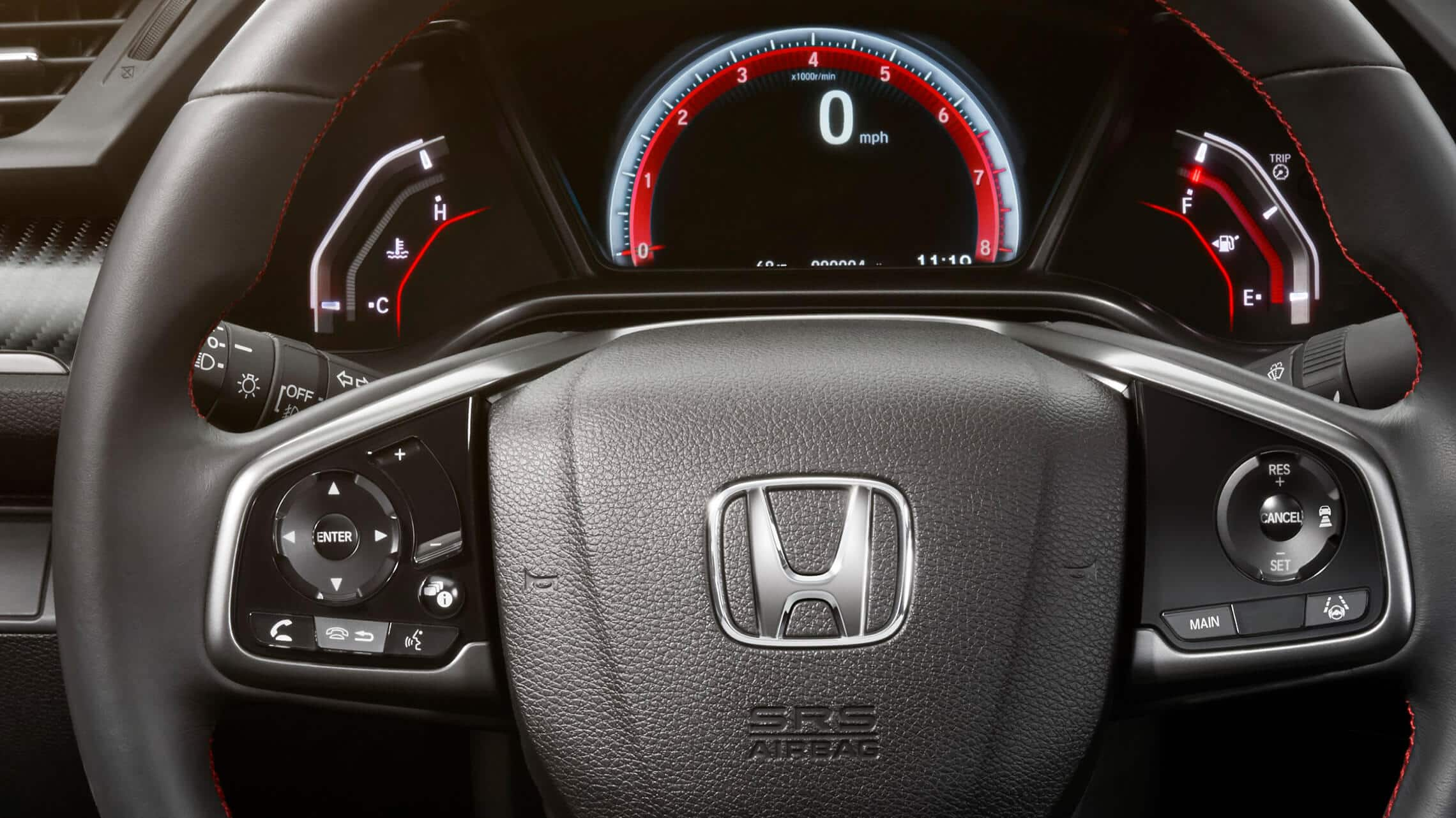Steering wheel-mounted controls detail on 2020 Honda Civic Si Sedan.