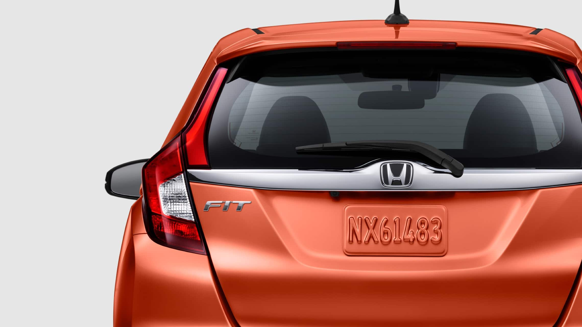 Exterior rear view of LED brake lights on the 2020 Honda Fit EX-L in Orange Fury.