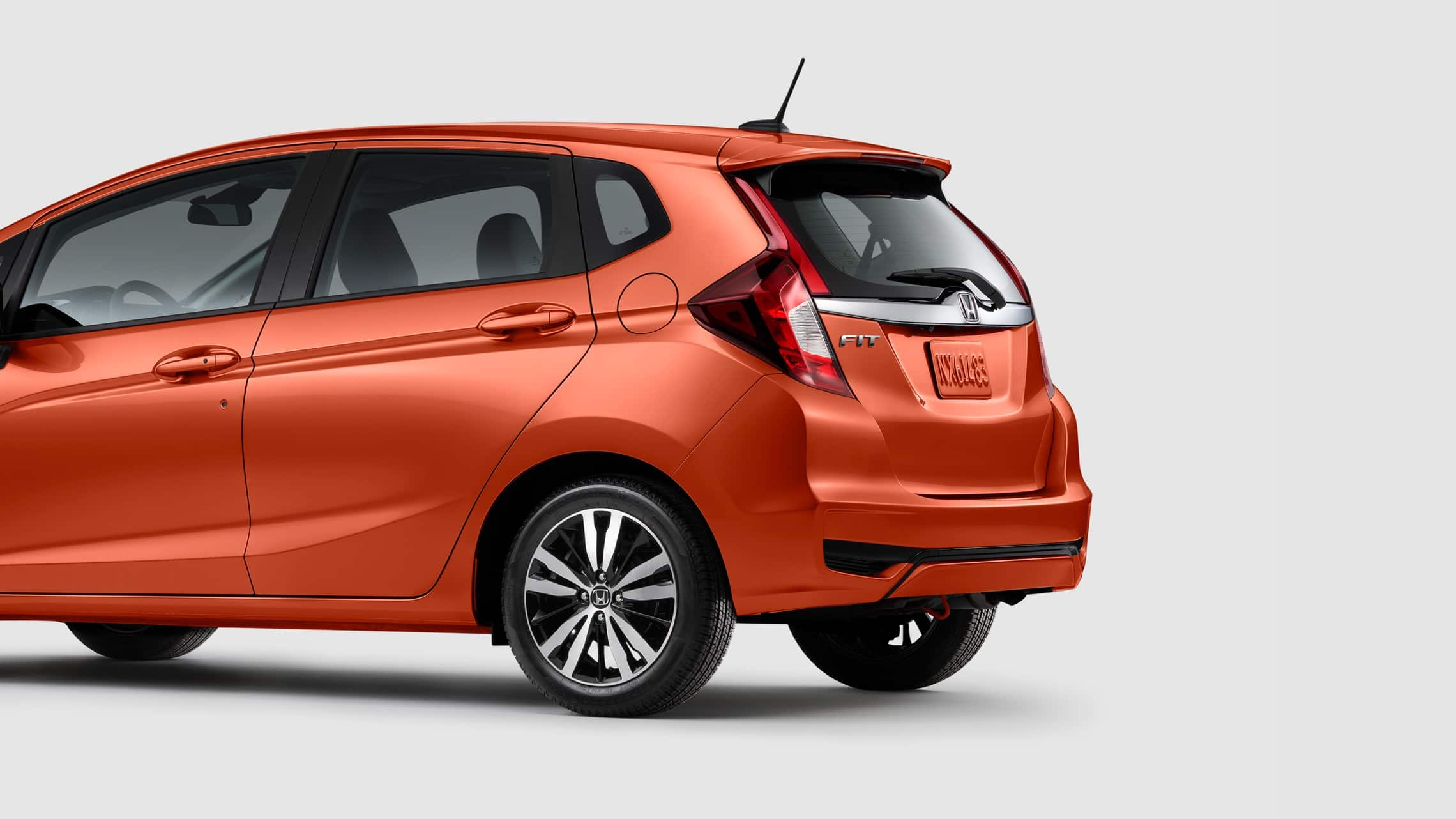 Rear driver-side view of the 2020 Honda Fit EX-L in Orange Fury.