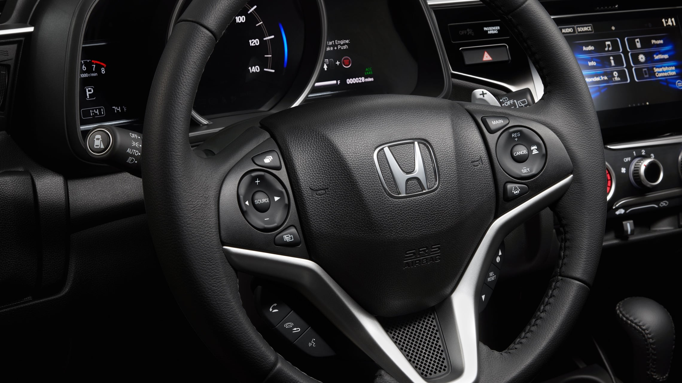 Steering wheel-mounted control detail on the 2020 Honda Fit EX-L.