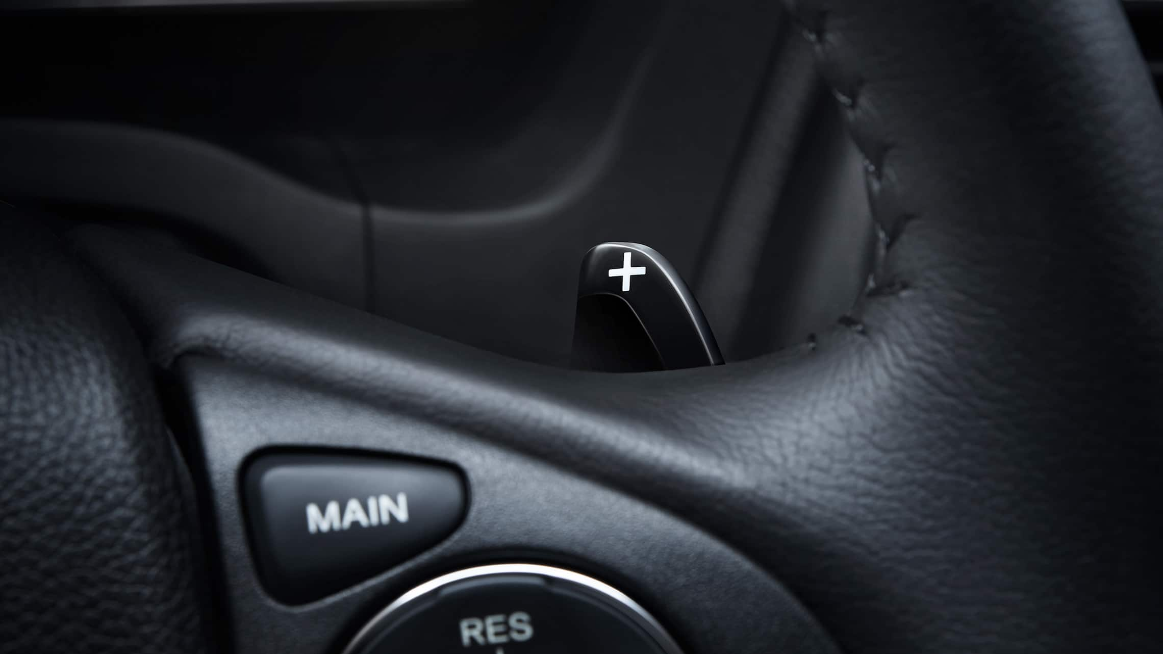 Detail view of paddle shifter on steering wheel in the 2020 Honda HR-V Touring.