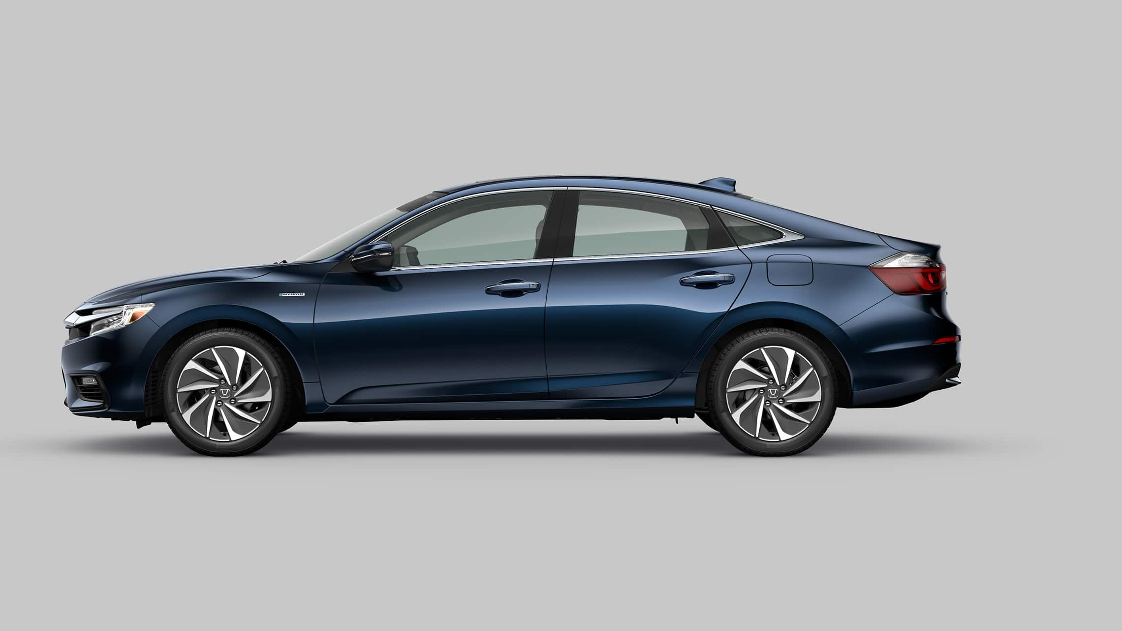 Driver's side profile view of 2020 Honda Insight Touring in Cosmic Blue Metallic.