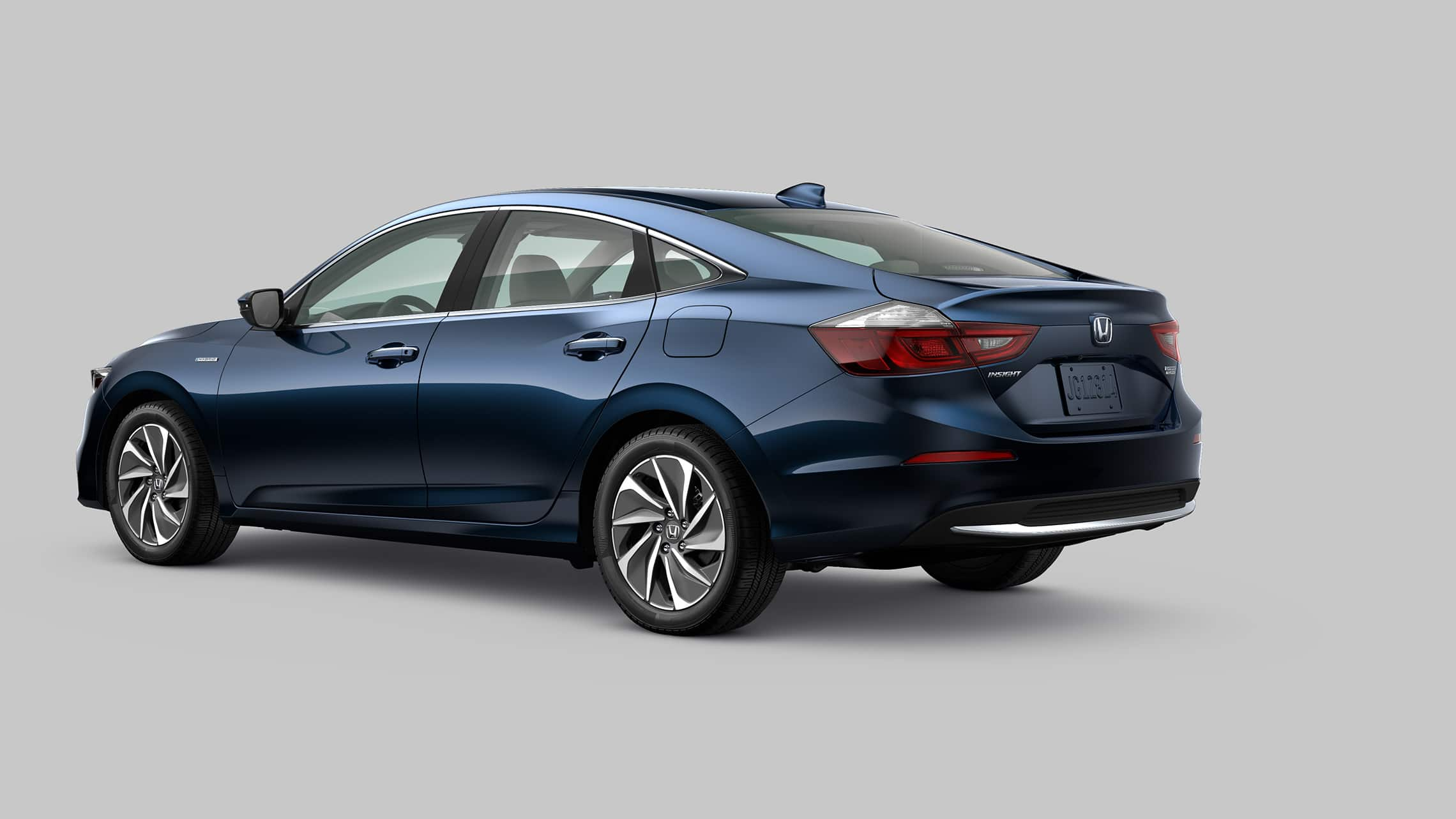 Rear 3/4 driver's side view of 2020 Honda Insight Touring in Cosmic Blue Metallic.