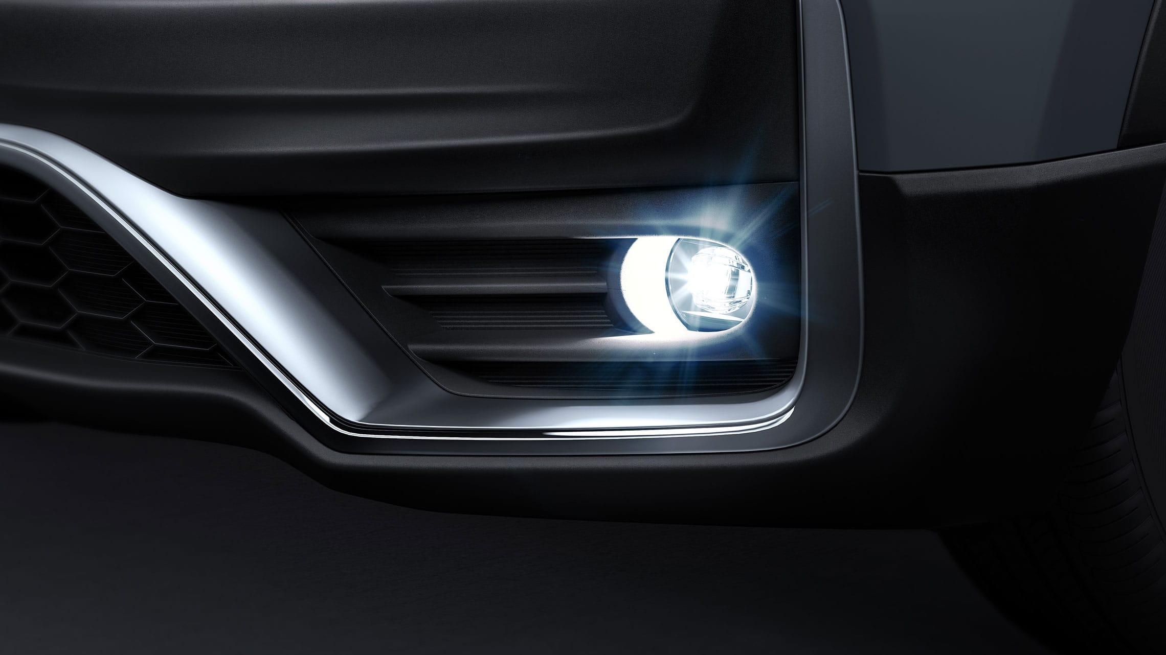 Driver-side fog light detail shot on the 2021 Honda CR-V Touring in Sonic Gray Pearl.