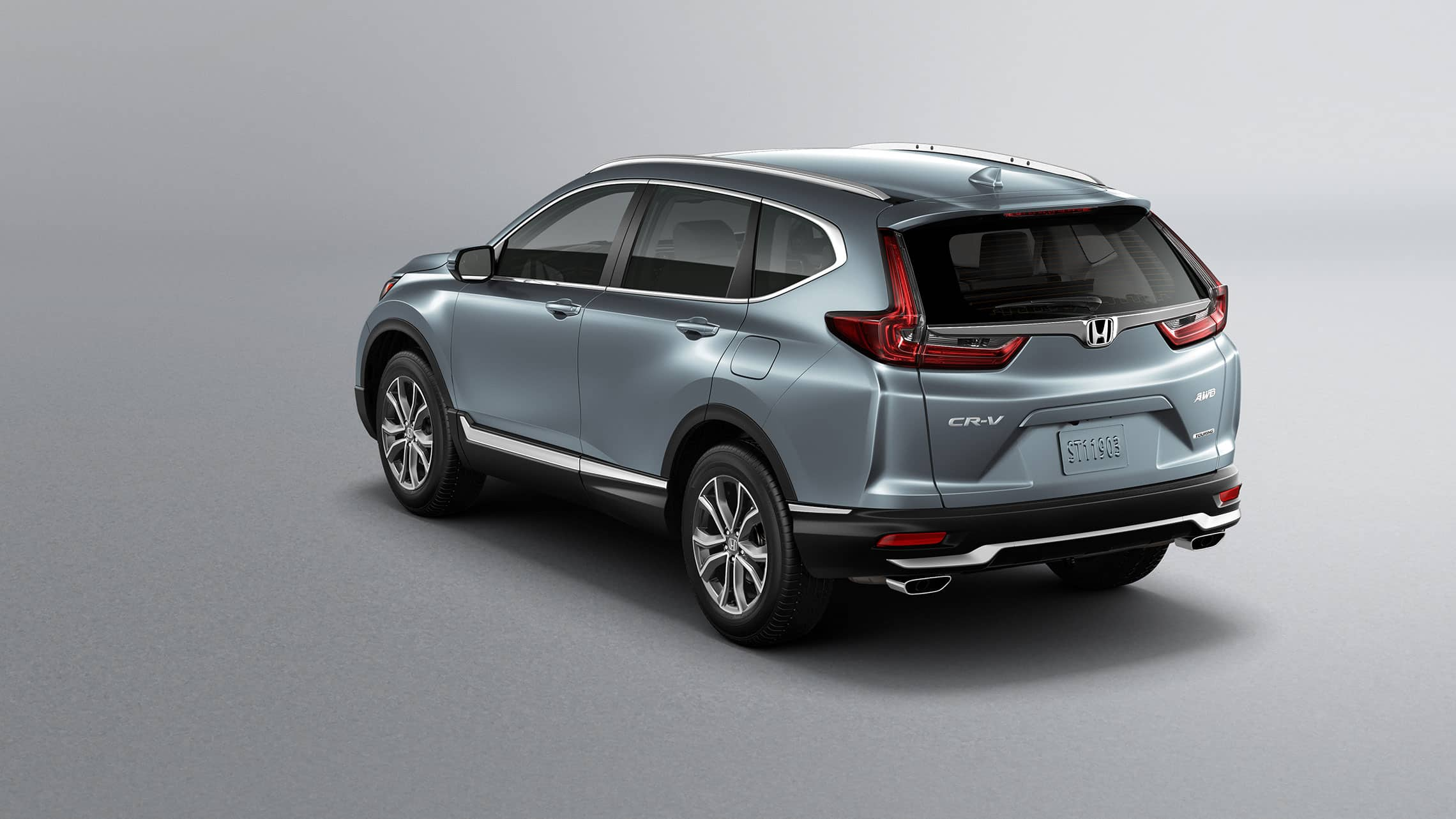 Rear driver-side view of the 2021 Honda CR-V Touring in Sonic Gray Pearl showing LED taillights.