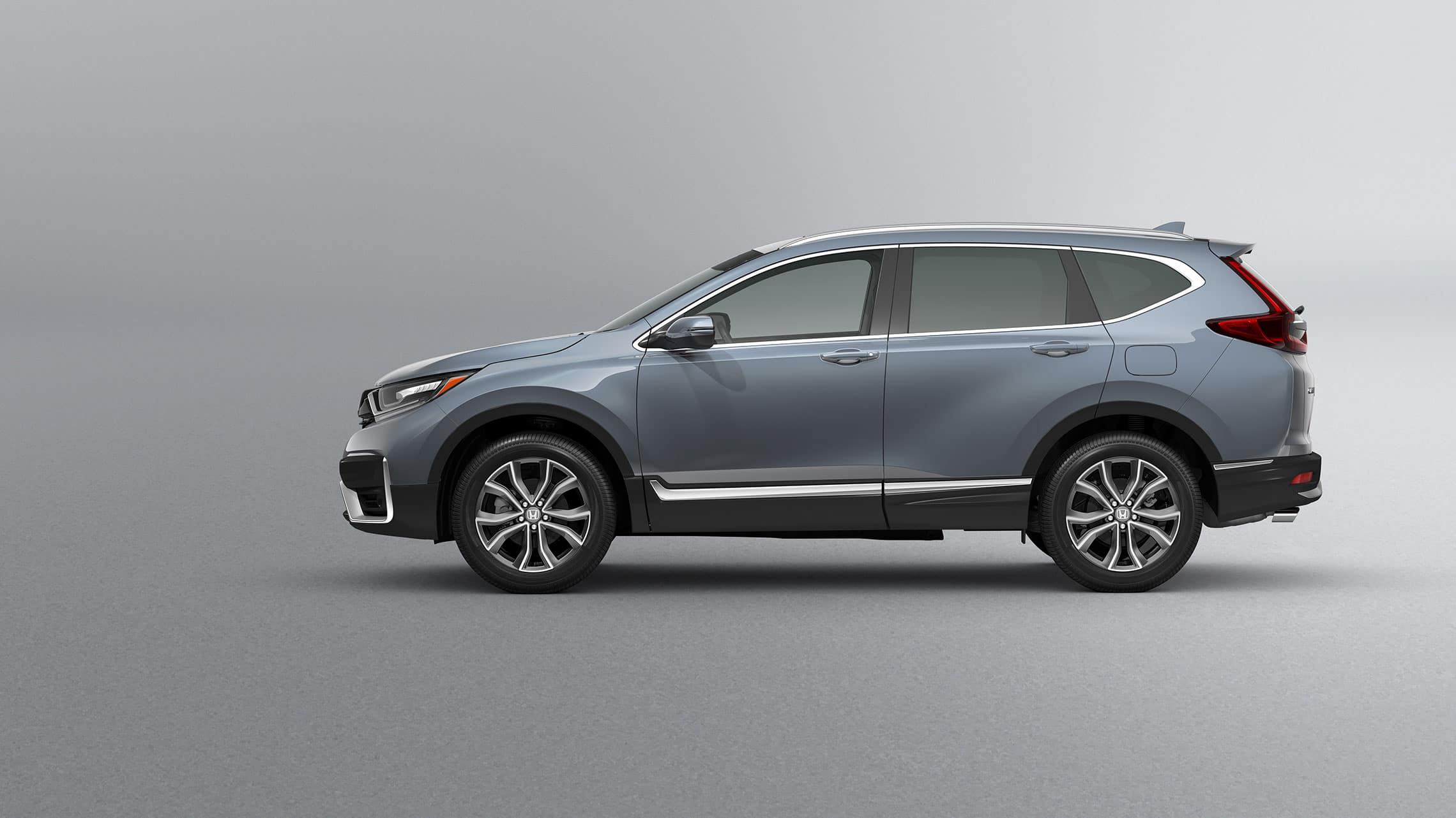 Driver-side profile view of the 2021 Honda CR-V Touring in Sonic Gray Pearl.
