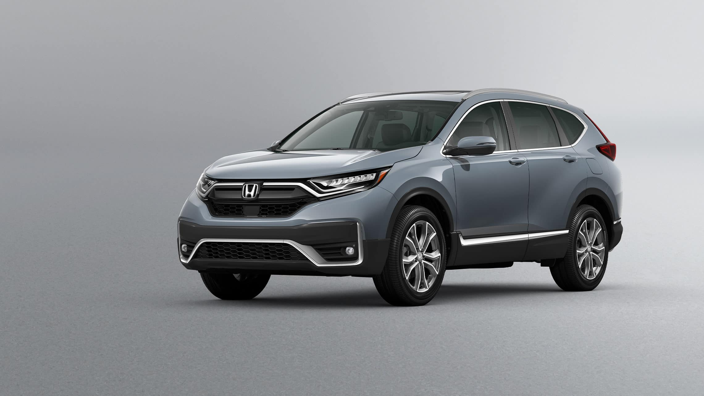 Front driver-side view of the 2021 Honda CR-V Touring in Sonic Gray Pearl.