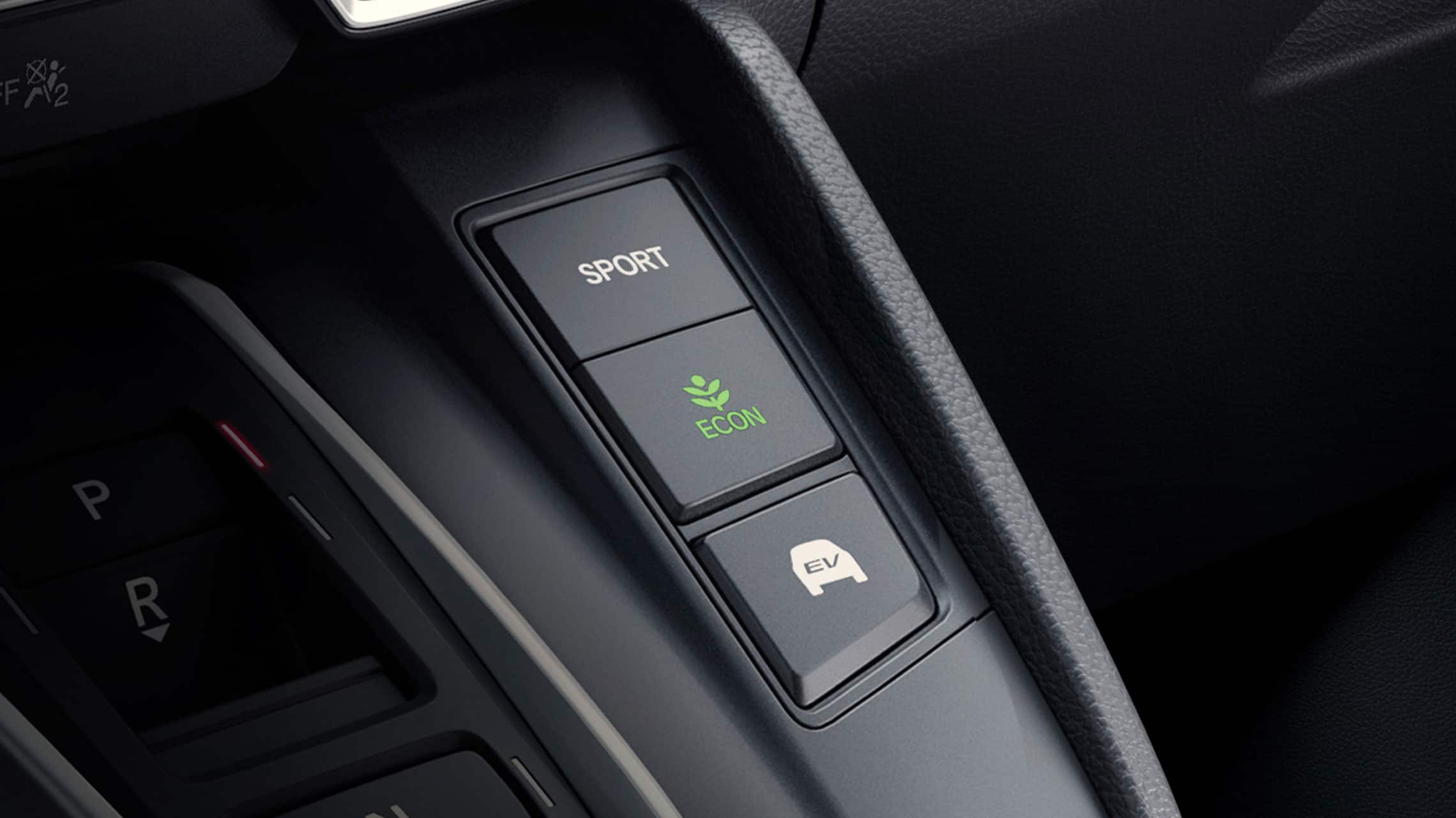 Detail view of the 2021 CR-V Hybrid Touring drive mode buttons.